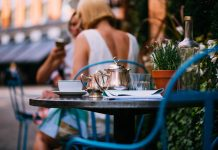 Outdoor luxury restaurant terrace, afternoon tea, tea pot on tables in mayfair, good lifestyle, London